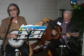 Tim Gurry and Kevin Manning do a rendition of the popular and jovial World War 1 tune 'Dink Di'.